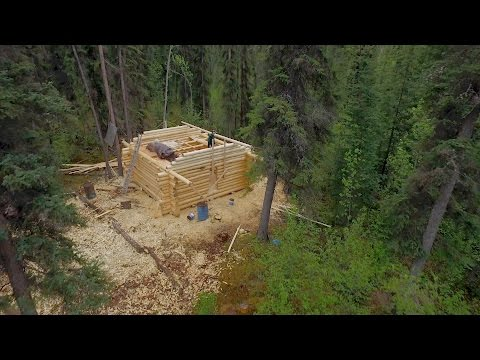 Will This Frontiersman Finish Building His Cabin Before The Snow Flies?