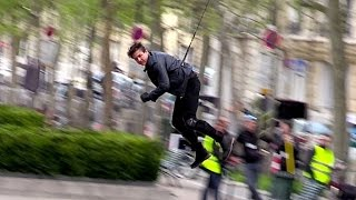 Tom Cruise performing an amazing stunt riding a motorbike and jumpi...