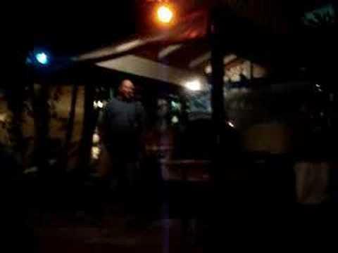 big bald guy singing karaoke