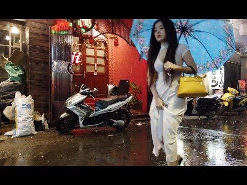 Walking Around Massage Street in Saigon, Vietnam. Work Shift in a Rainy Night