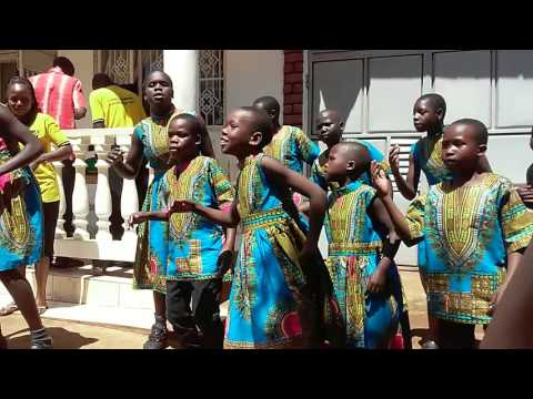 Children sing at Uganda office