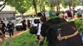 Antifa marches through Portland clashing with riot police during Patriot Prayer rally thumbnail