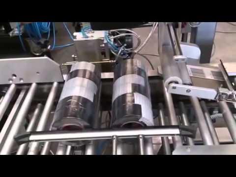 เครื่องติดฉลากสติ๊กเกอร์ Labelling Sytems for Cylindrical Shrink Packaging of Adhesive Tapes