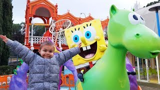 Funny Baby in Nickelodeon Park for Kids Ride on POWER WHEEL Car Family Fun Playtime