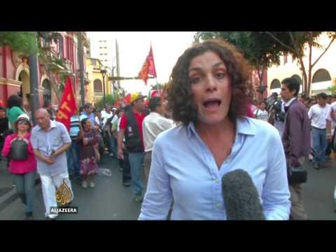 Thousands protest over Peru's labour laws