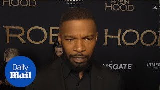 Suited up! Jamie Foxx is dapper at the Robin Hood premiere