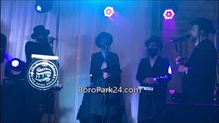 Lipa Shmeltzer and Shmueli Unger performing at a wedding in Boro Park