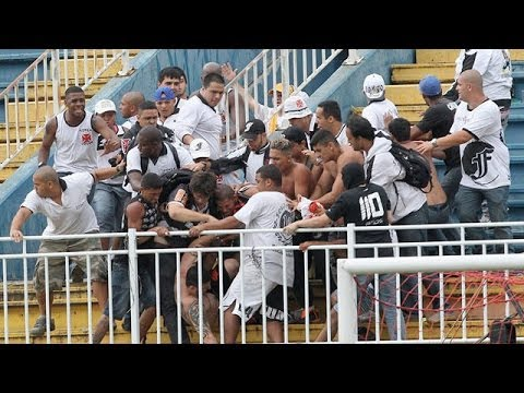 Brazilian police fire rubber bullets as violence flares at football match