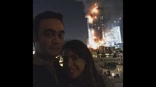 Couple posts inappropriate selfie, with burning building in backdrop