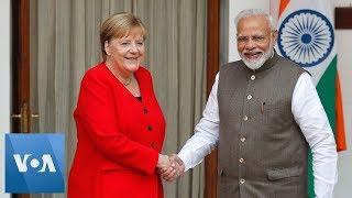 PM Narendra Modi and Angela Merkel Meet in India Ahead of Trade Talks