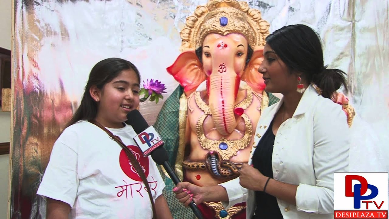 Young devotee talking to Desiplaza TV about the arrival of Ganapati Murthy