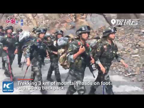 Armed police in Beijing undergo harsh field training