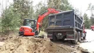 Loading a 10 Wheel Dump Truck with KX 057