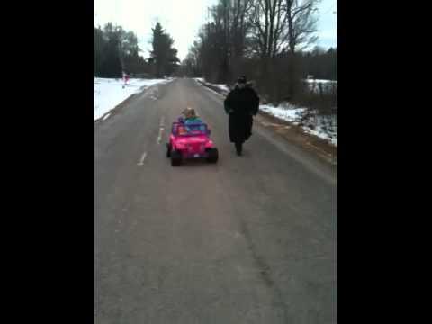 Charlotte Orr driving barbie jeep