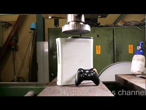 Crushing Xbox 360 with hydraulic press