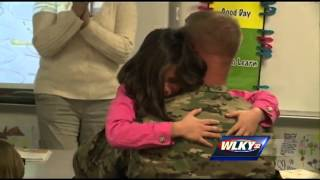 Soldier surprises daughter as belated birthday present