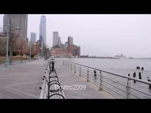 The embankment in Manhattan. Skyscrapers in New York, Hudson gulf.