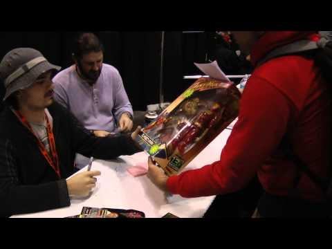 Jake Lloyd signs my Turbo Man action figure at Star Wars Celebration VI