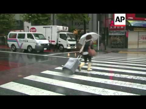 Residents in capital battle strong winds from Typhoon Wipha on their way to work