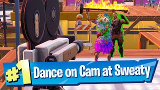 Dance on camera for 10 seconds at Sweaty Sands Location - Fortnite Battle Royale
