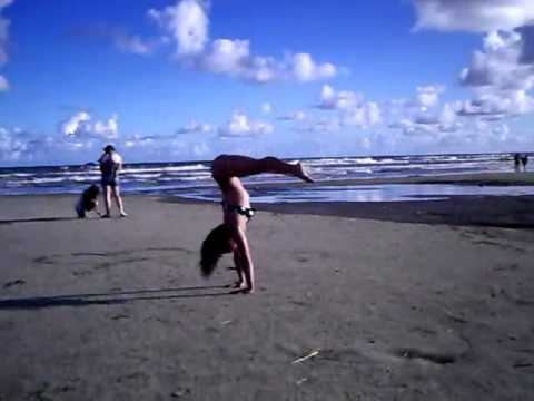 Handstand to press at the beach