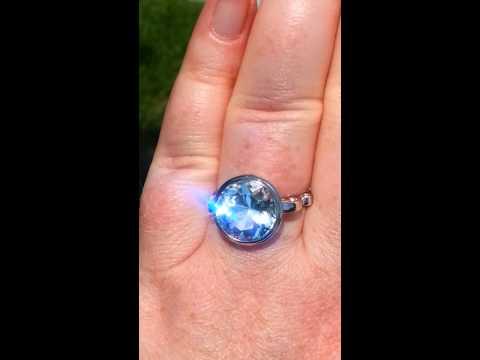 "Precision-Cut Aquamarine Engagement Ring in White Gold Bezel ""Sweet Pea"" Design"