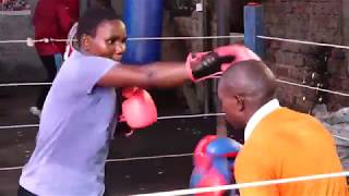 Ugandan Female Boxer admires May Weather Street Boxing part one