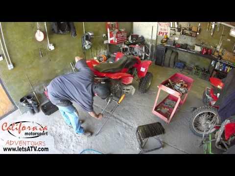 how to change rear bearing on honda atv