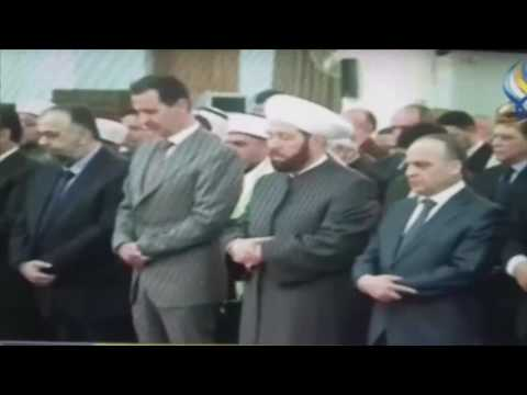 Syrian president Assad unable to stand still during prayers?