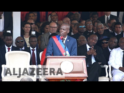 Haiti swears in new president after long-running crisis