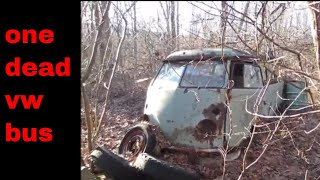 abandoned vw bus in the woods.