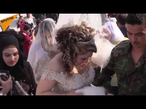 So Happy Together: 30 Couples Tie the Knot in Mass Aleppo Wedding