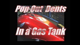 Pop Out Dents in a Motorcycle Gas Tank