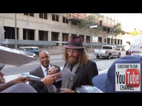 Christopher Backus greets  outside Ace Hotel in Los Angeles