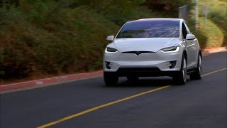 Car Tech - Tesla Model X: First drive of the all-electric SUV(Read more: http://cnet.co/1KQ26aJ Tesla's eagerly anticipated, all-electric SUV is finally being delivered to consumers. Join us as we get behind the wheel for ..., 2015-09-30T05:15:45.000Z)