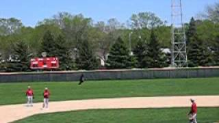 Guy runs across outfield in a gorilla costume