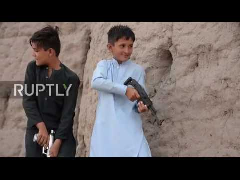 Afghanistan: Kids play with toy guns as child soldiers remain reality