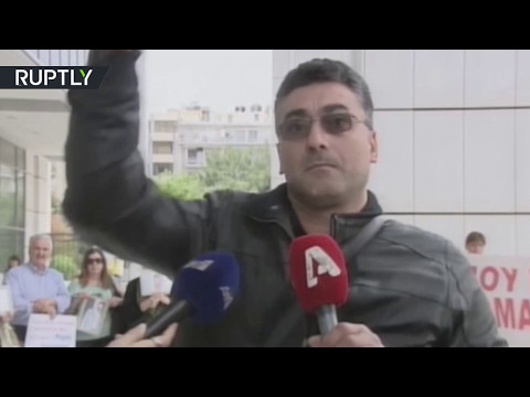 'Justice doesn't exist': Moment grieving uncle fires gun mid-interview in Athens