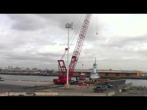 Loading. MANITOWOC crane on a barge