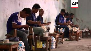 Inmates at a prison in Indonesia have found their own ticket to Brazil in the form of a soccer ball.