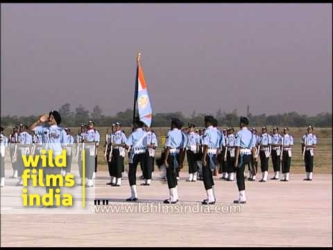 Indian Air Force (IAF) officers march with IAF flag