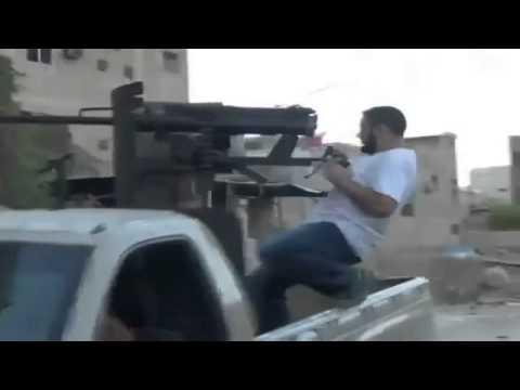 Attack anti aircraft machine gun civil war Syria rebel army laden with track