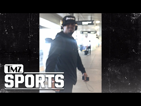 Marshawn Lynch Smacks Phone from Fan at LAX, Spits | TMZ Sports