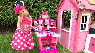 Nastya is waiting for Mickey and Minnie Mouse and is cooking in the children\'s play kitchen.
