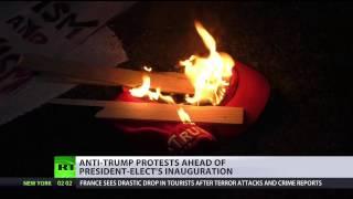'No Donald Trump, no KKK, no racist USA!': Protesters in NYC, Washington rally ahead of inauguration