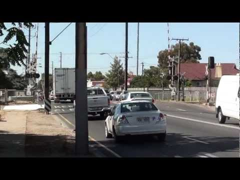 South Road will choke if train service on  Outer Harbour Line is increased. Adelaide Video Feb 2013