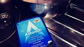 Cleaning a dirty frying pan with astonish original oven and cookware cream cleaner