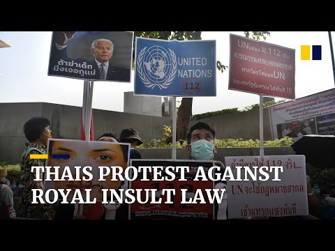 Thai demonstrators gather near UN office calling for action against royal insult law
