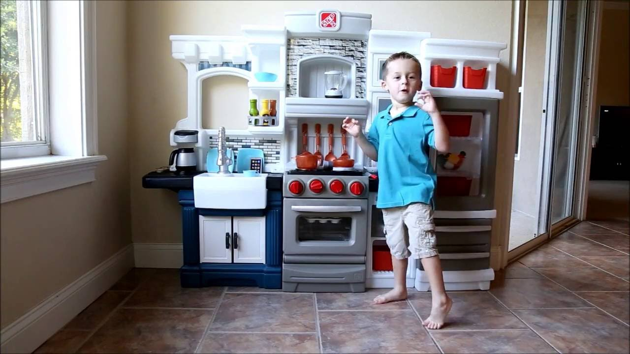 Kids test the Step2 Grand Luxe Kitchen