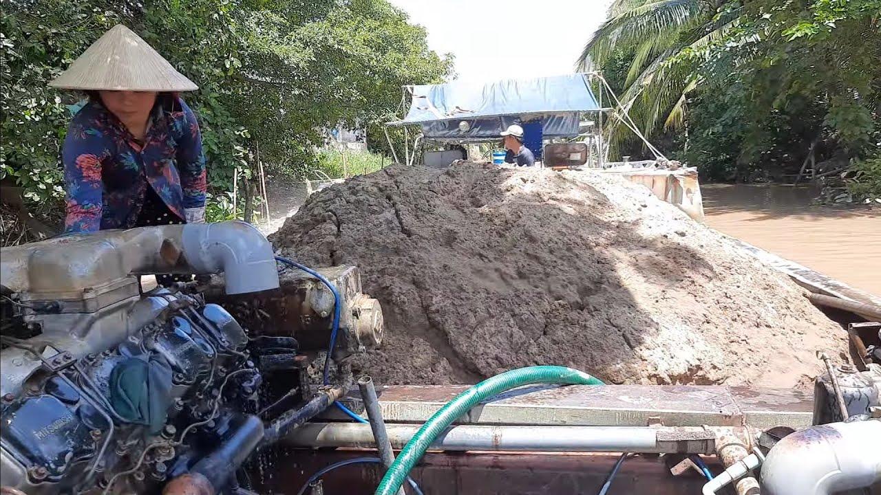 Cảnh bơm cát nền nhà và bơm cát xây/Sand pump on the floor and construction sand pump
